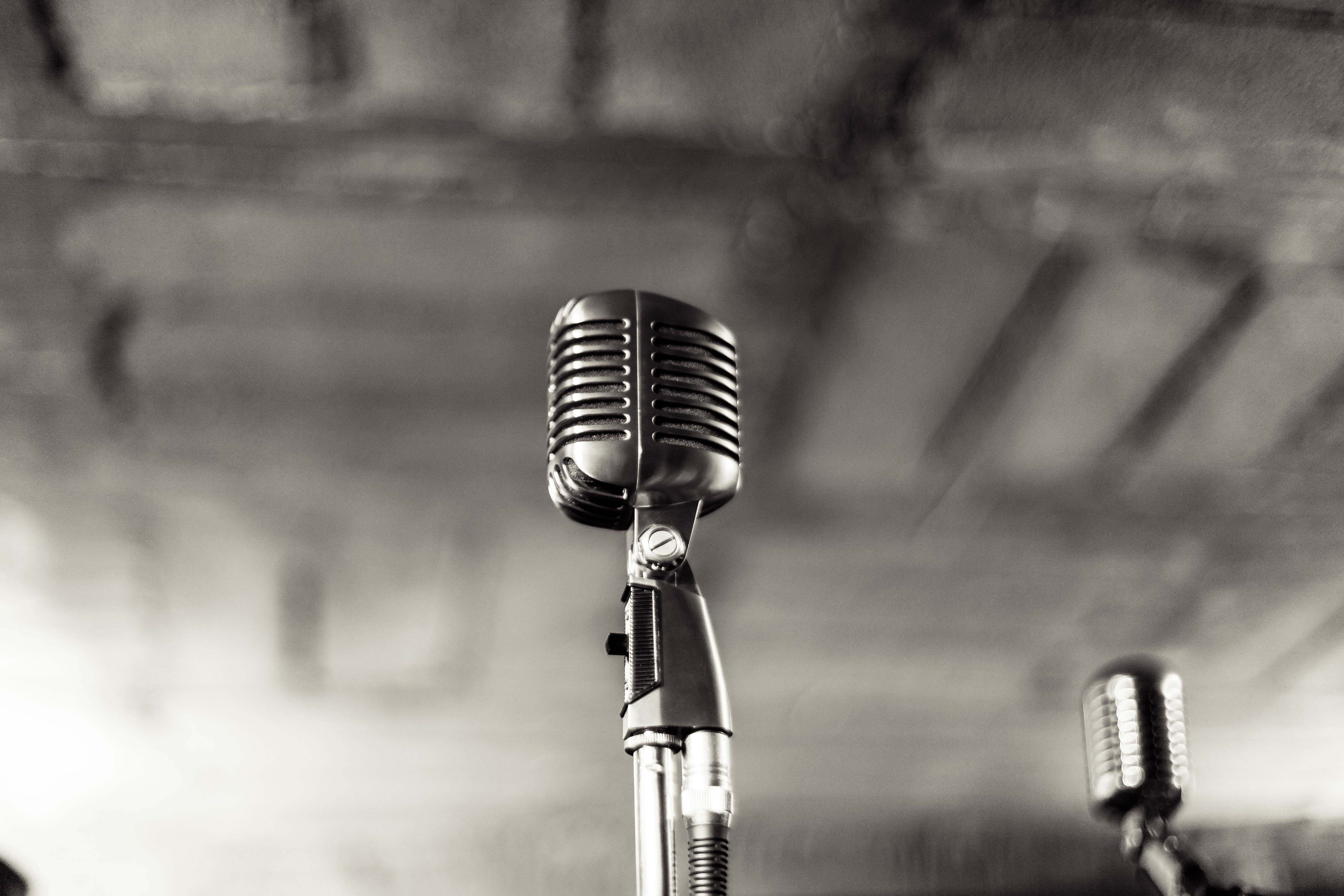Selective Focus Photography of Grey Condenser Microphone With Stand