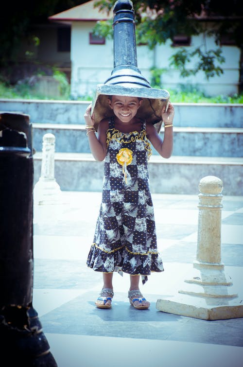 Photo of Girl Carrying Giant Chess