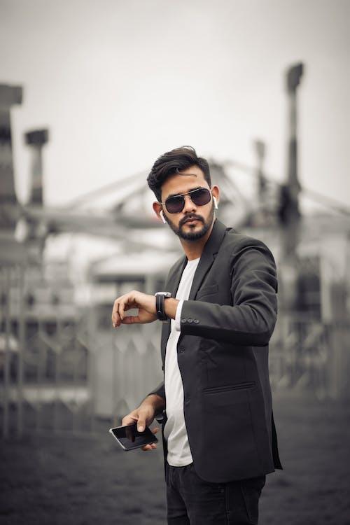 Man in Black Suit Jacket Wearing Black Sunglasses