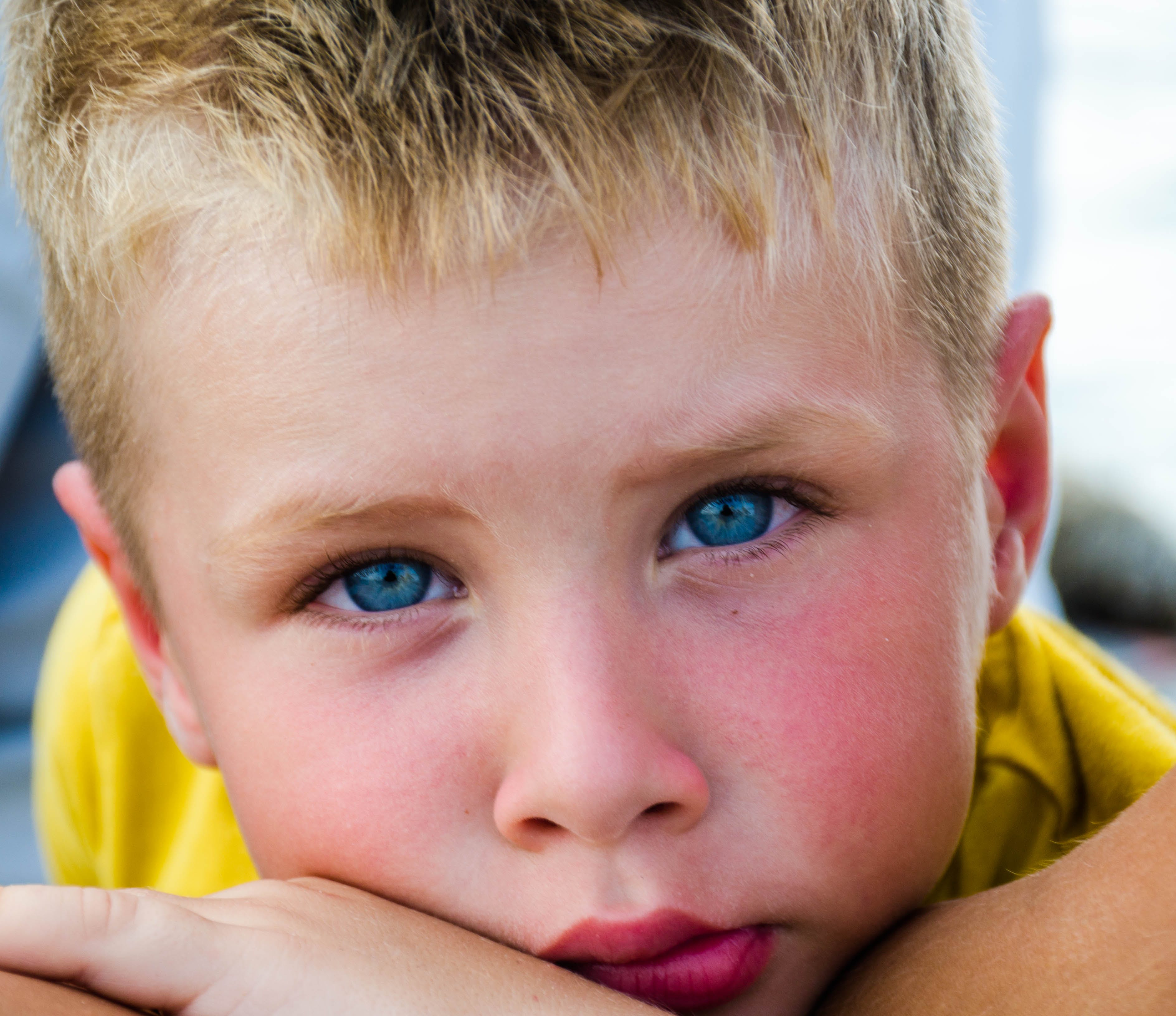 Close-Up Photography of Boy With Blue Eyes