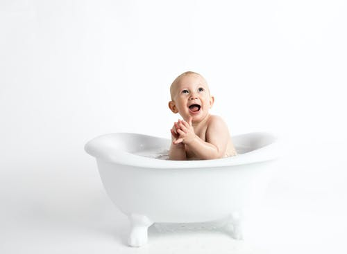 Baby Inside White Bathtub With Water