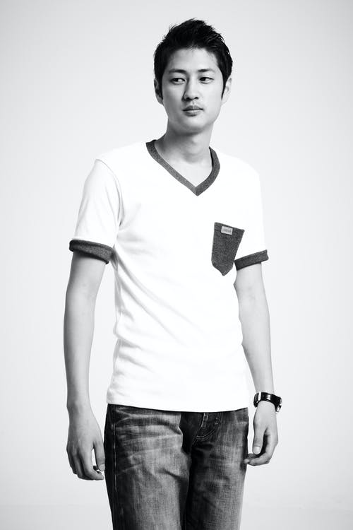 Greyscale Photo of Man in V-neck T-shirt