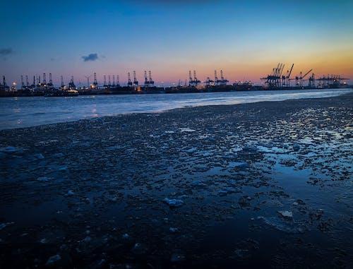 คลังภาพถ่ายฟรี ของ ชายทะเล, ตะวันลับฟ้า, ทะเล, ท่าเรือ