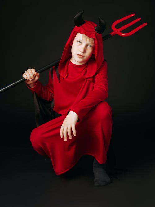 Woman in Red Hijab Holding Stick