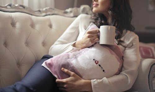 Woman in White Long-sleeved Shirt Holding White Ceramic Mug