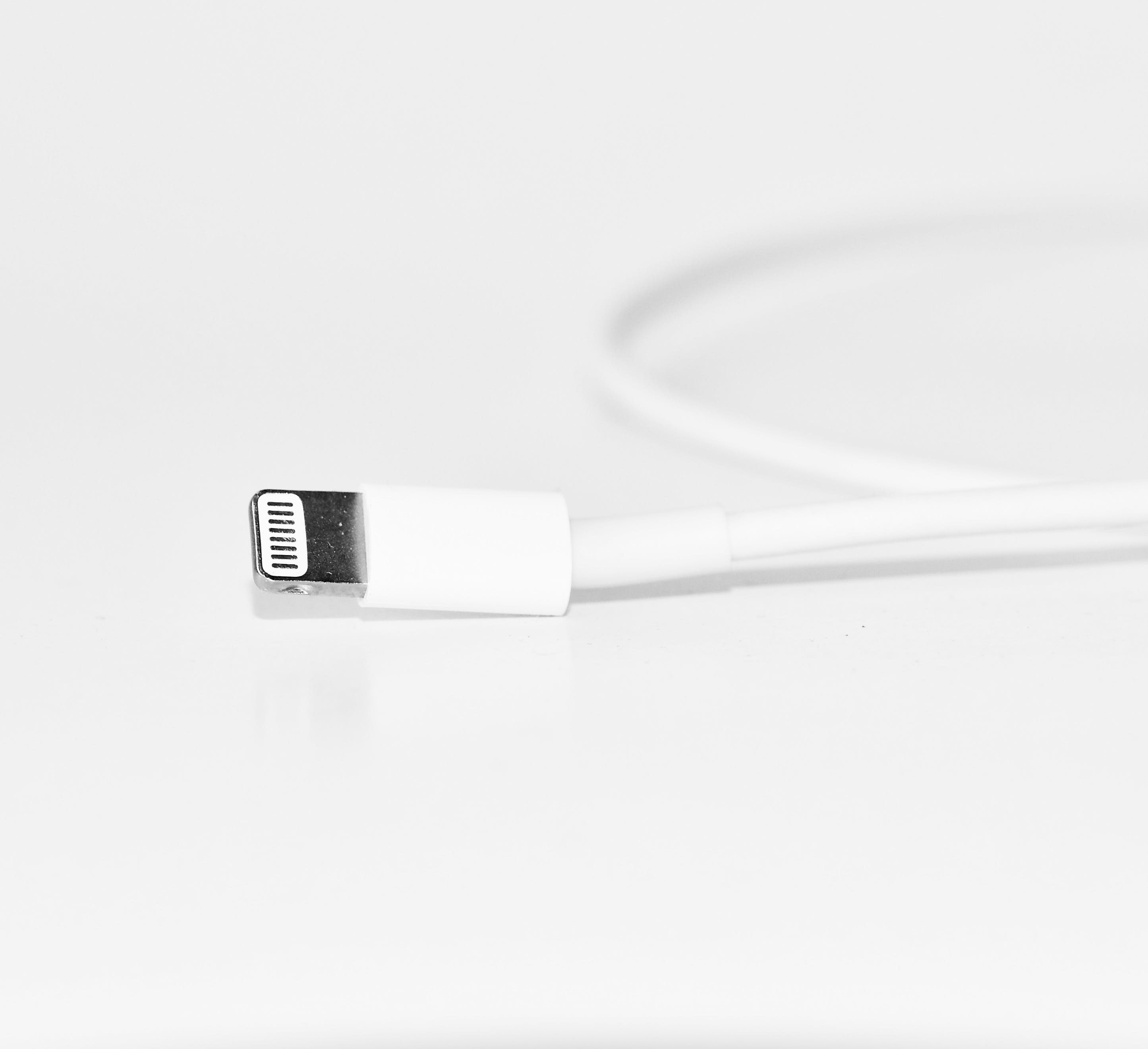 Close-Up Photography of White iPhone Charger