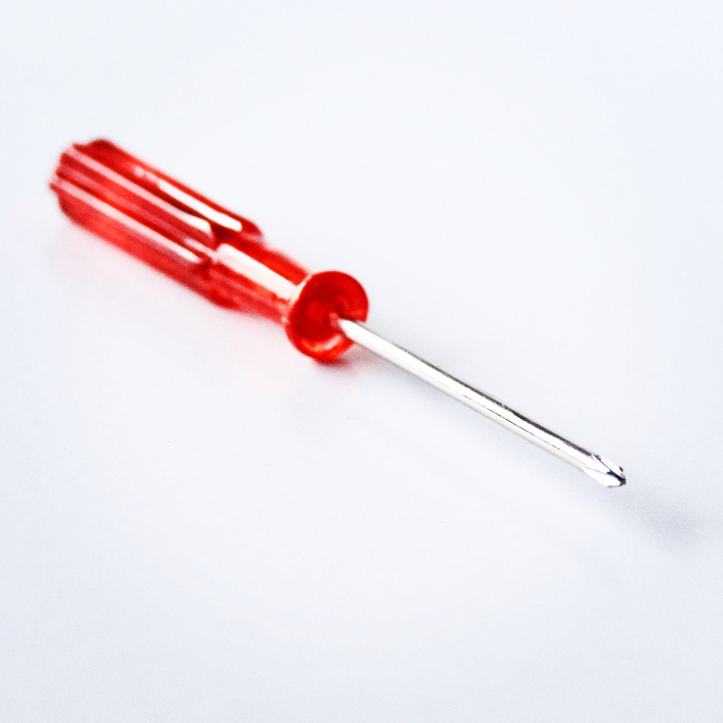 Close-Up Photography of Red Screwdriver
