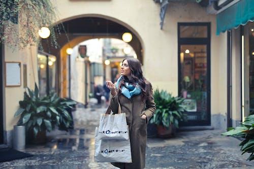 Woman in Brown Full-zip Long-sleeved Coat With Tote Bags