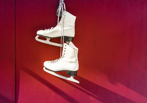 Hanged Pair of White Leather Figure Skates