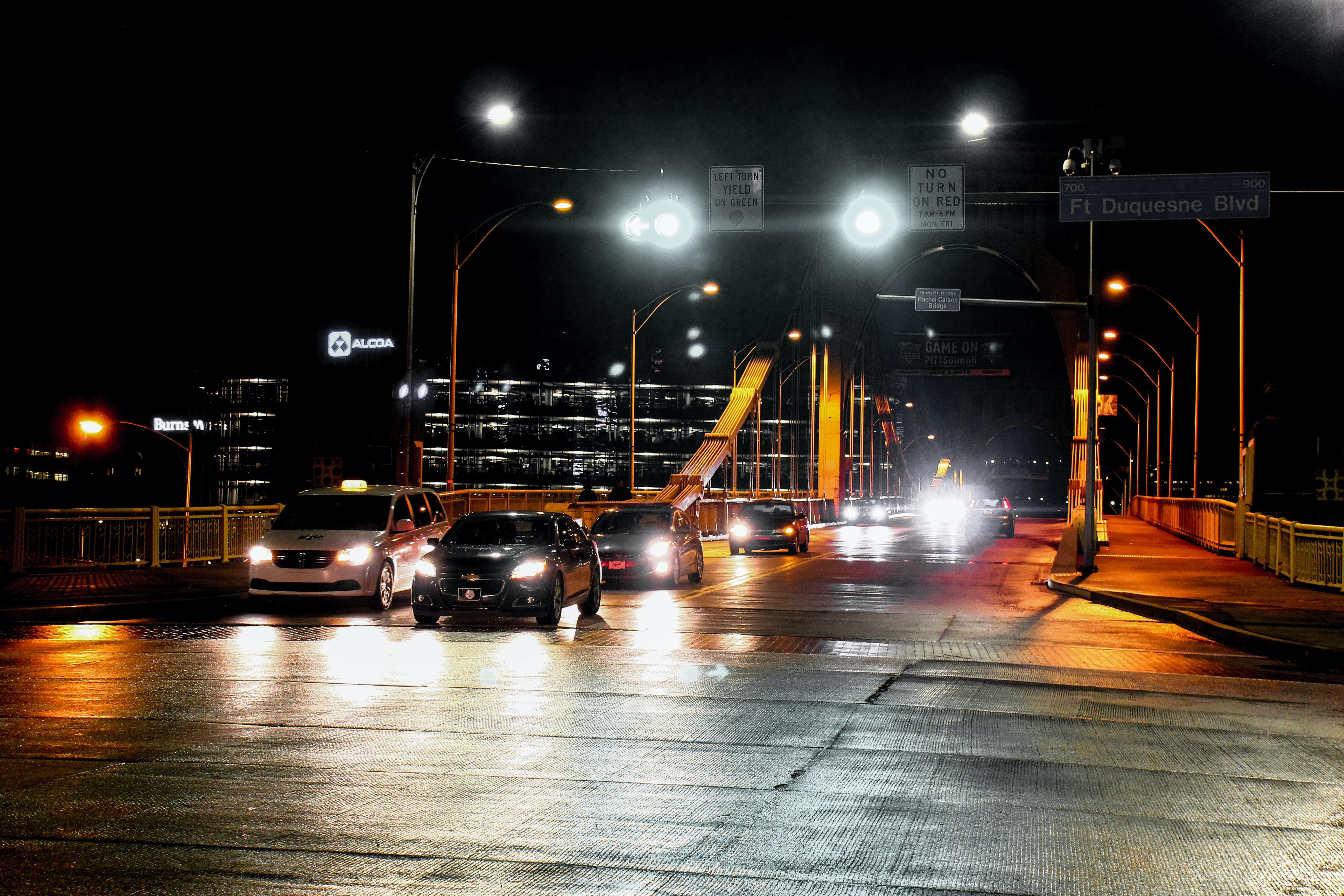 Vehicle on Road at Night