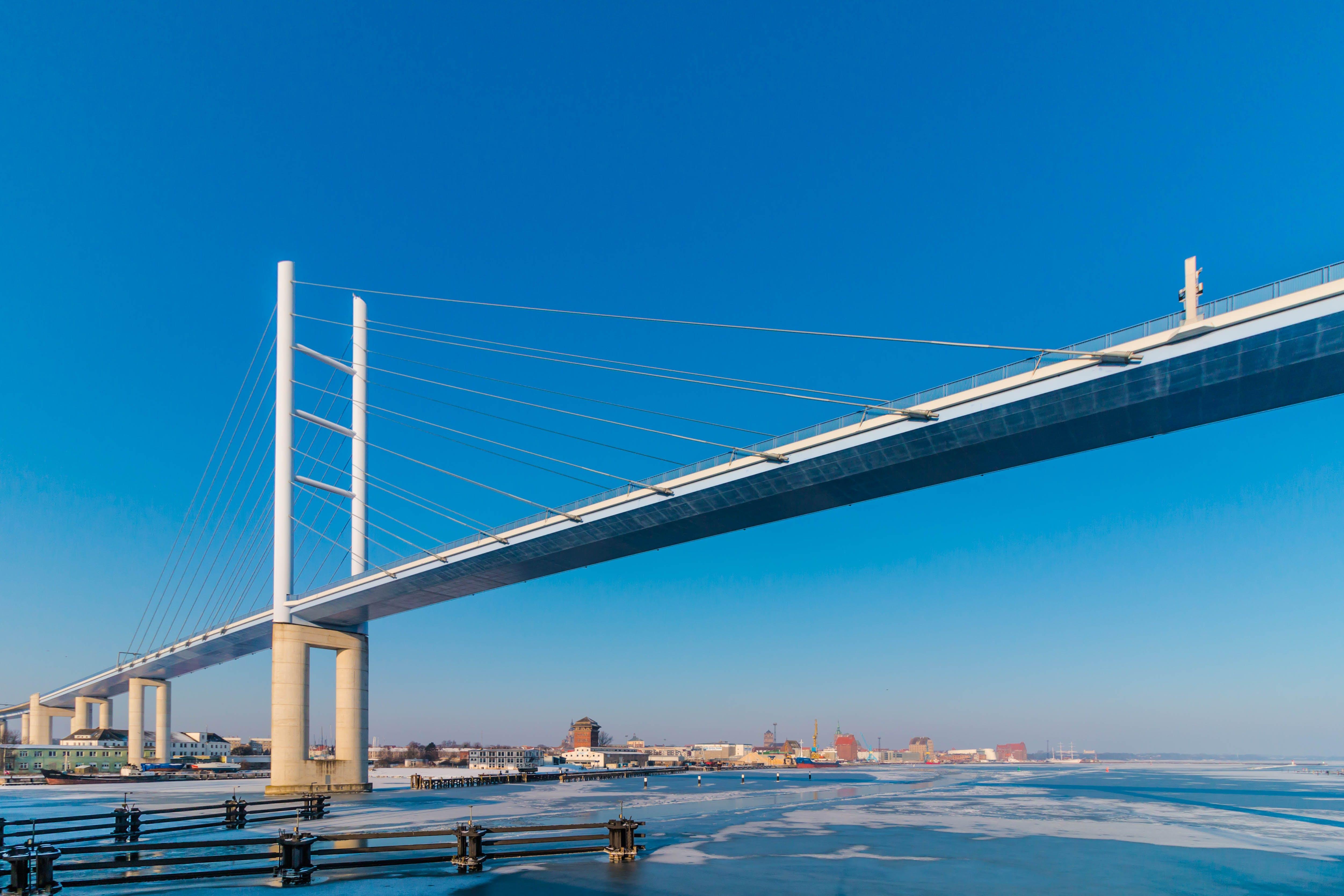 White Metal Bridge Under the Blue Sky