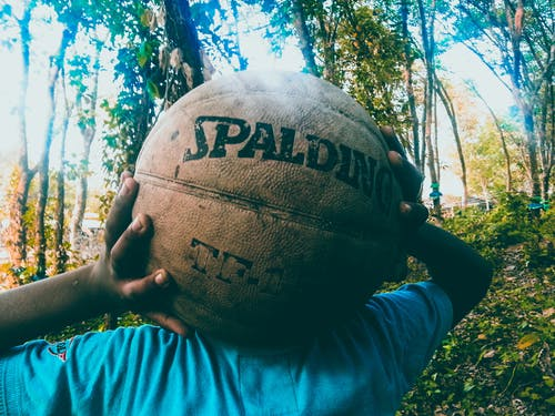 Person Holding Brown Spalding Basketball