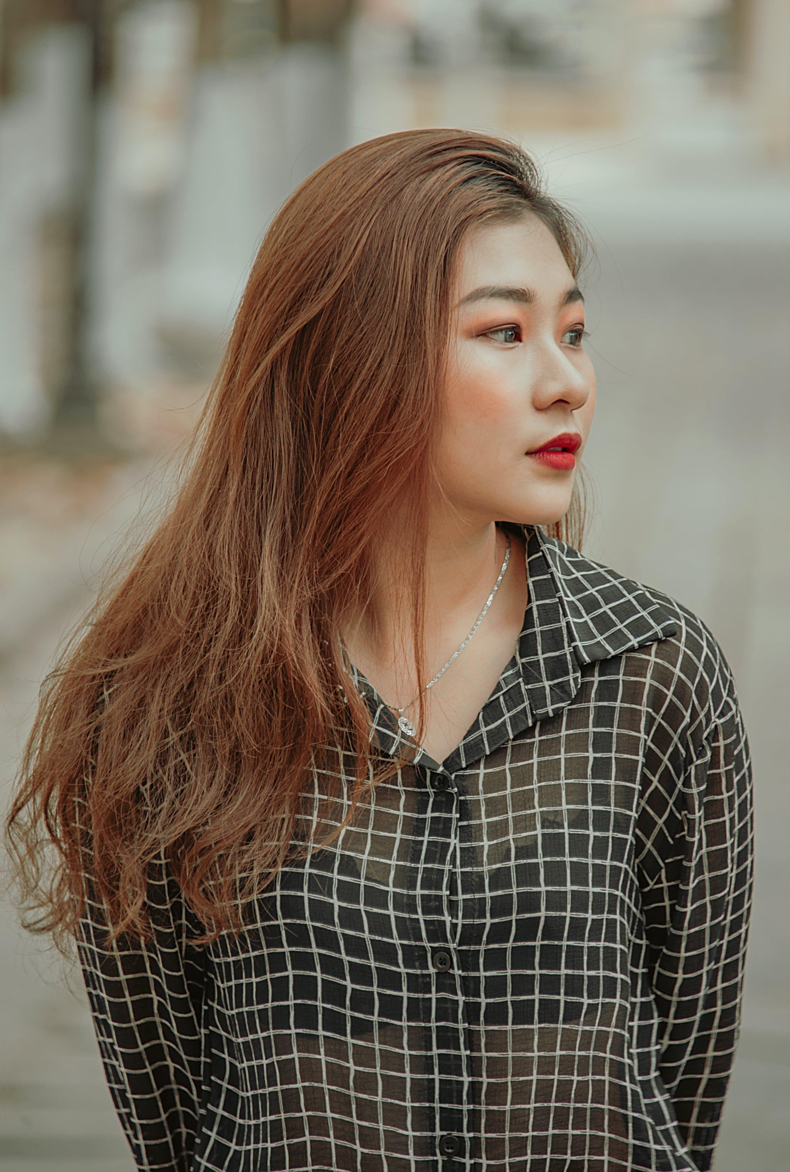 Woman Wearing Black and White Checkered Dress Shirt