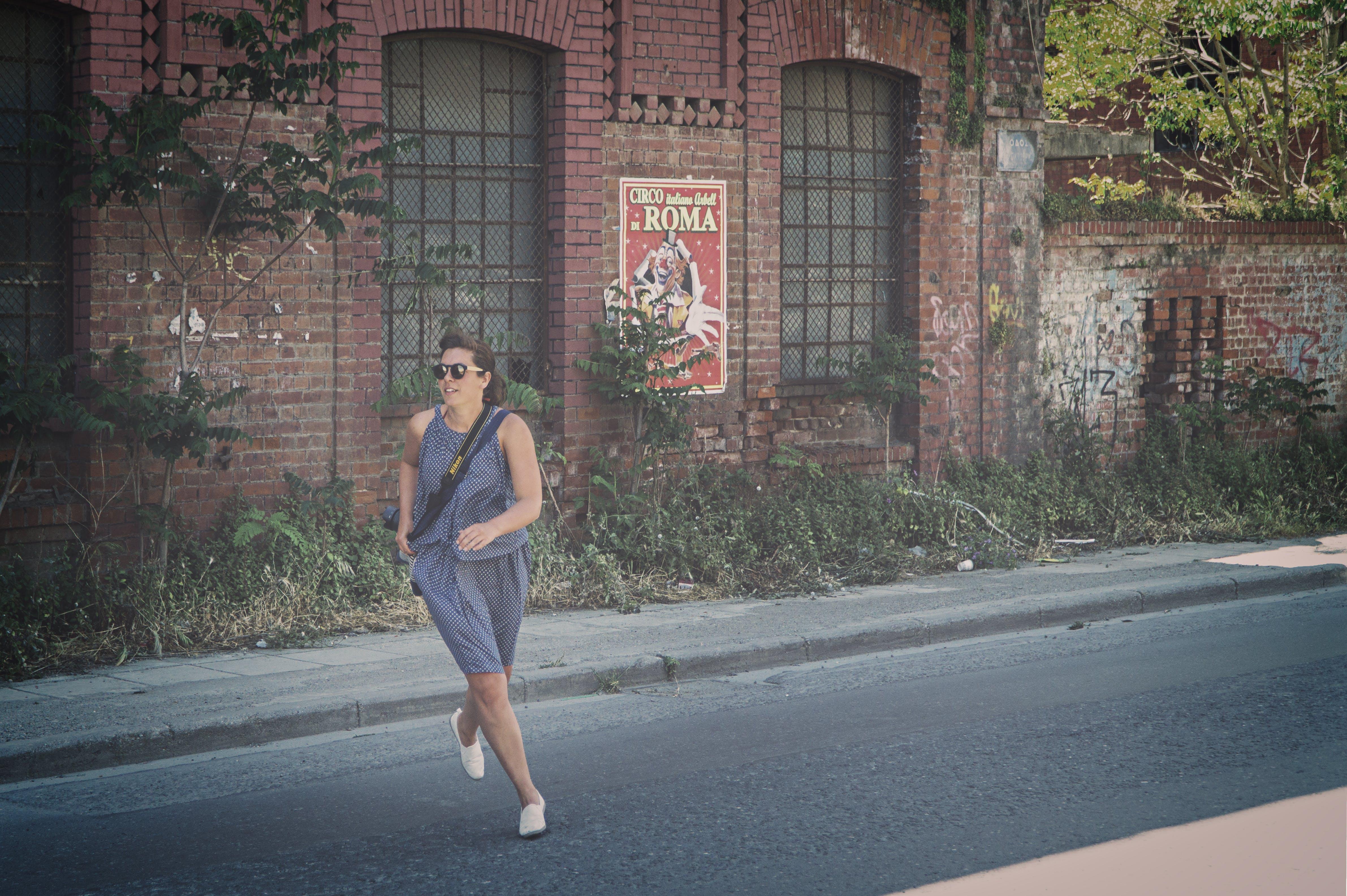 Woman in Blue Tank Dress Running on Road