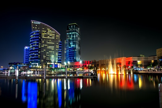 City Skyline Beside Water during Night