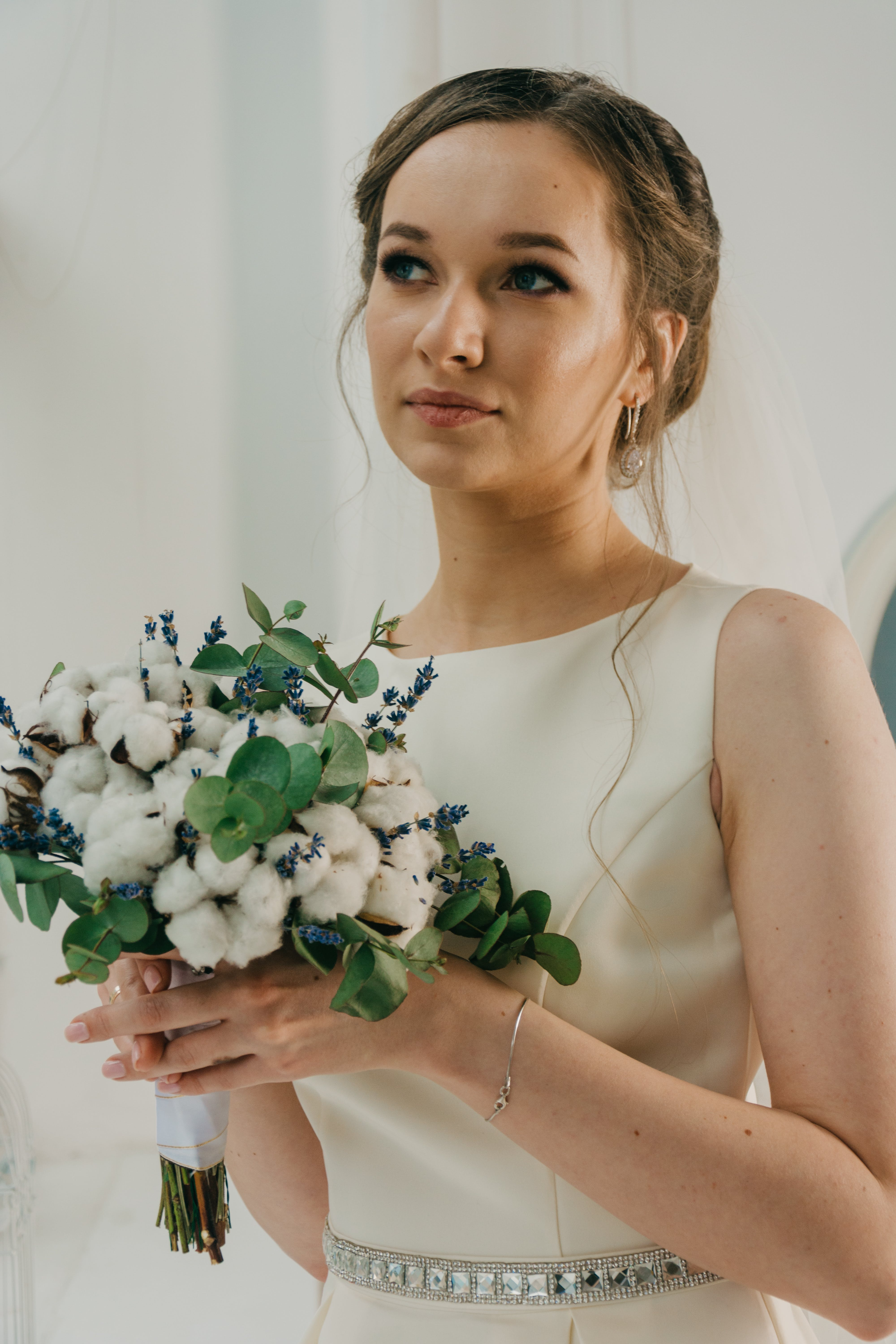 Woman Wearing White Gown Holding Bouquet of Flowers