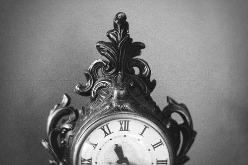 Black Wooden Framed Analog Clock at 10 00