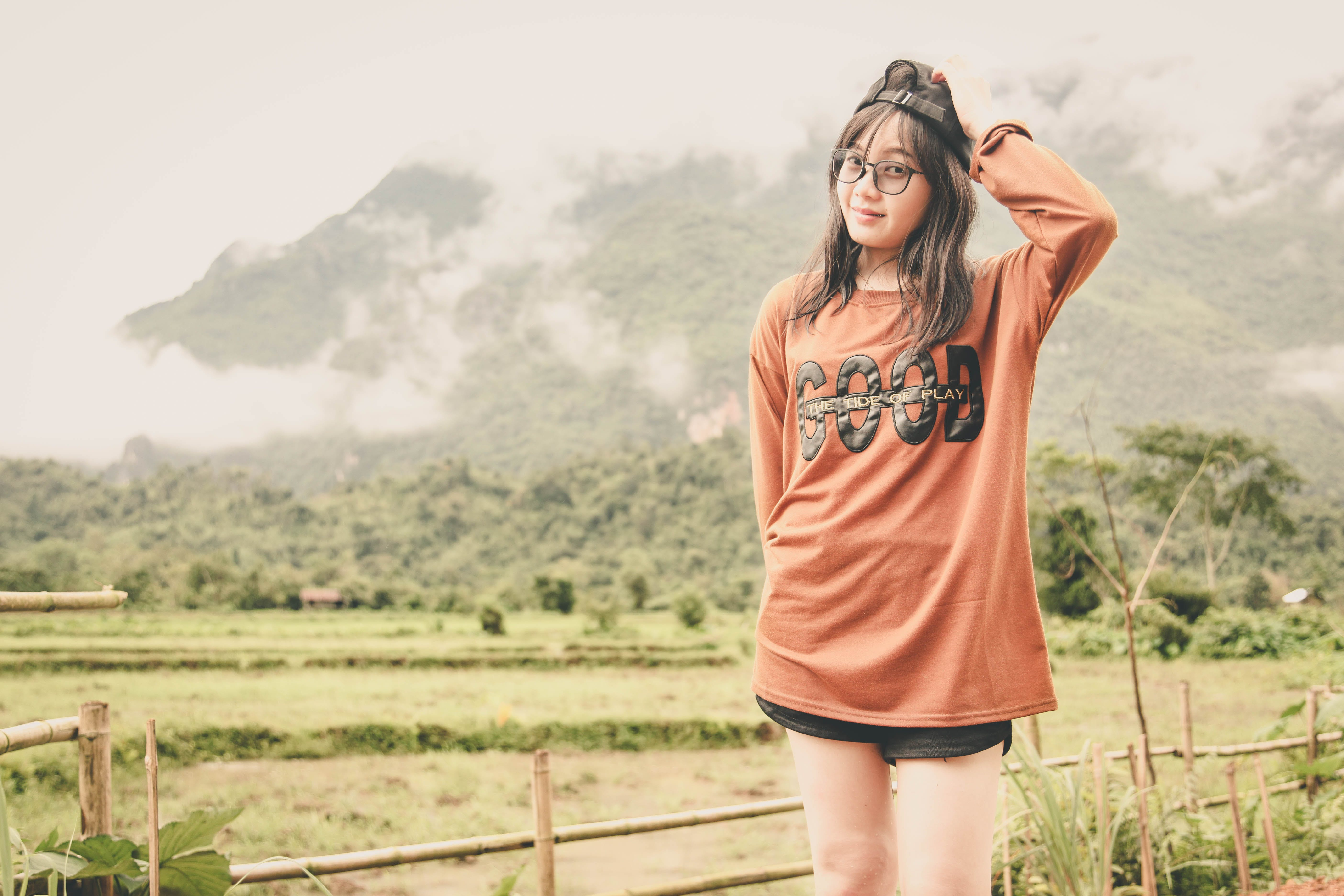 Woman Wearing Orange Long-sleeved Shirt