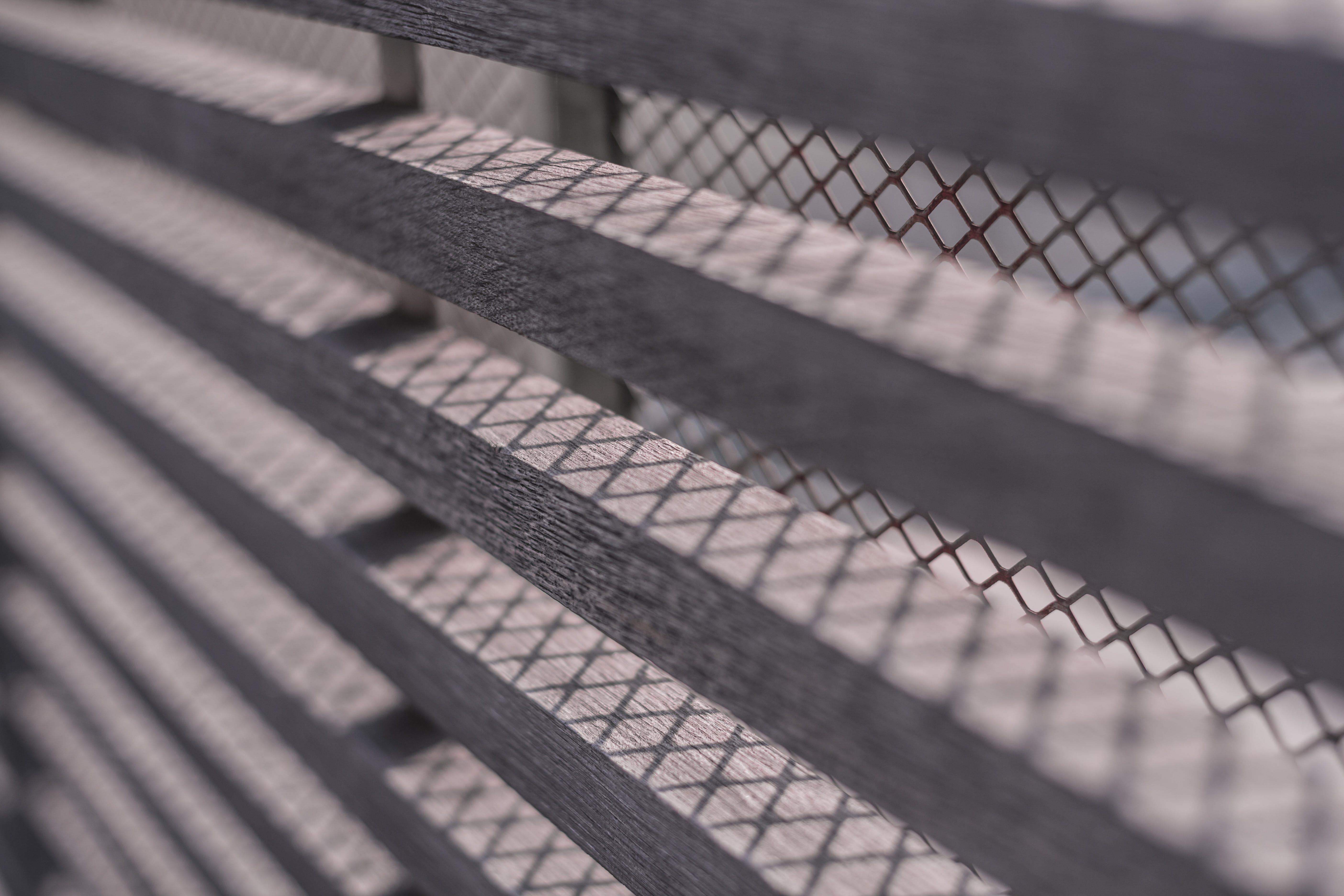 Close-up Photography of Brown Window Grills