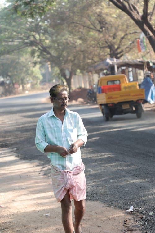 Free stock photo of man walking on village road