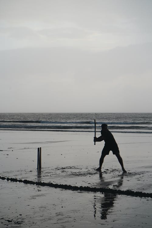 Silhouette of Person on Seaside