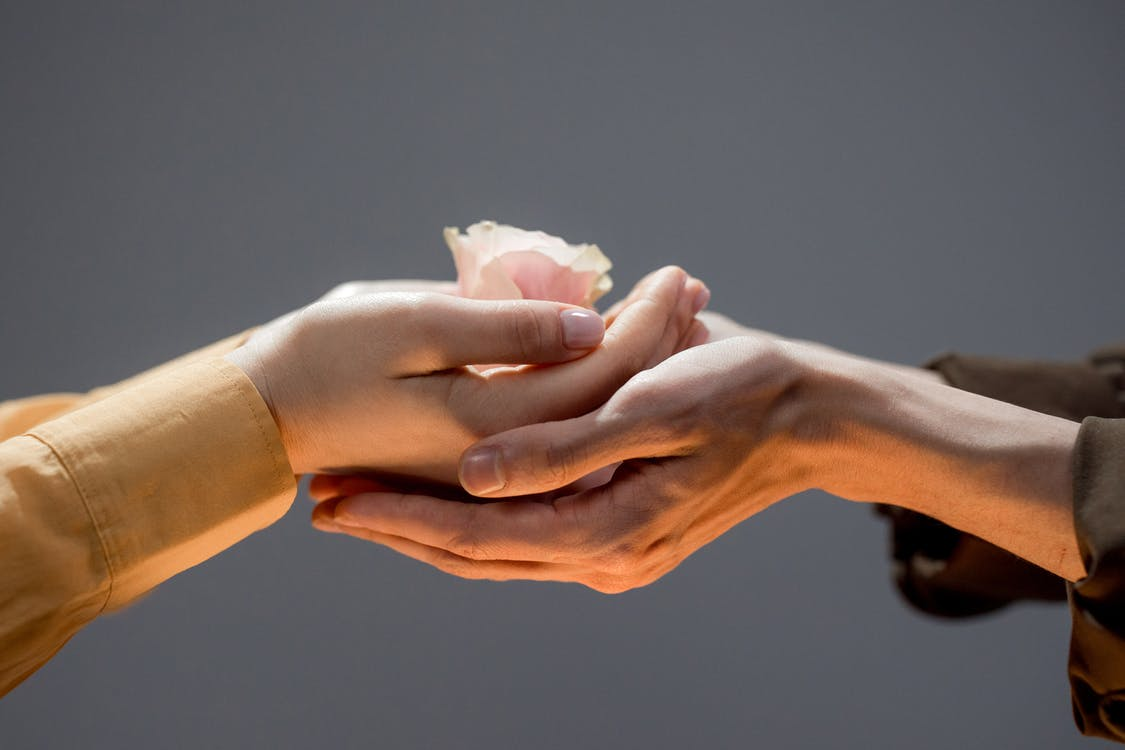 Person Holding White Tissue Paper