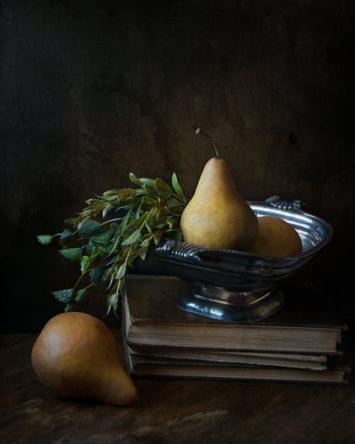 Peaches on Footed Bowl over Book