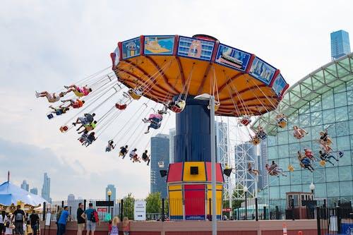People Riding in Swing Carousel
