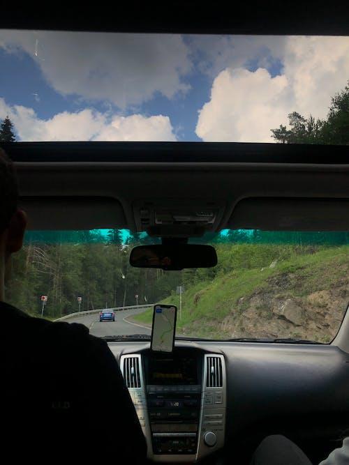 Person in Black Jacket Sitting Inside Car