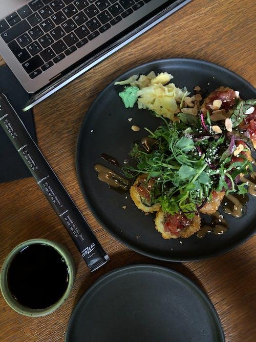Black Ceramic Plate With Vegetable Salad