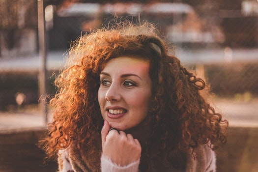 Woman Curly Hair With White Long-sleeved Top
