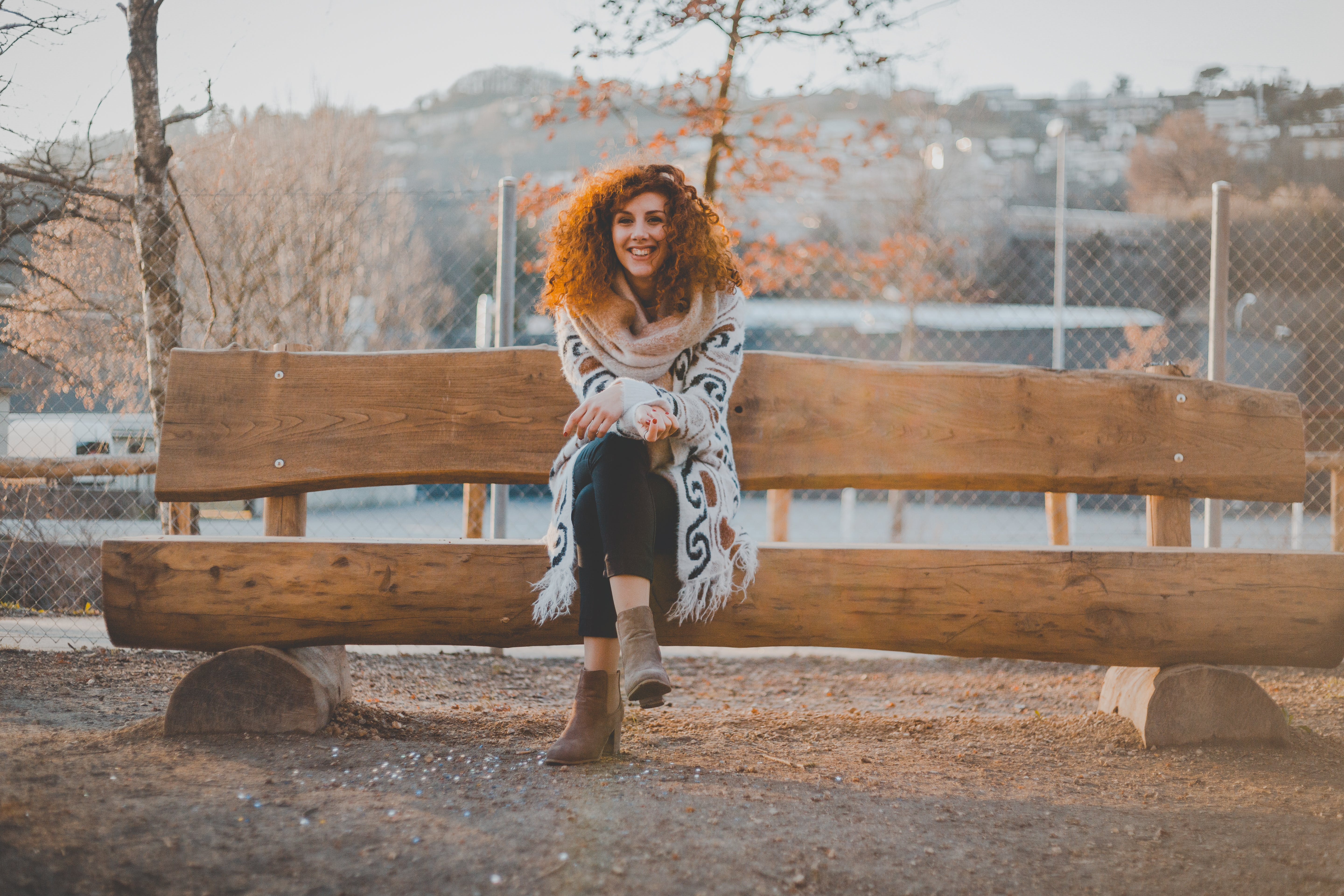 Woman Wearing Floral Cardigan Sit on Bench