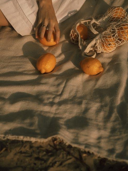 Ripe Lemons on Brown Textile