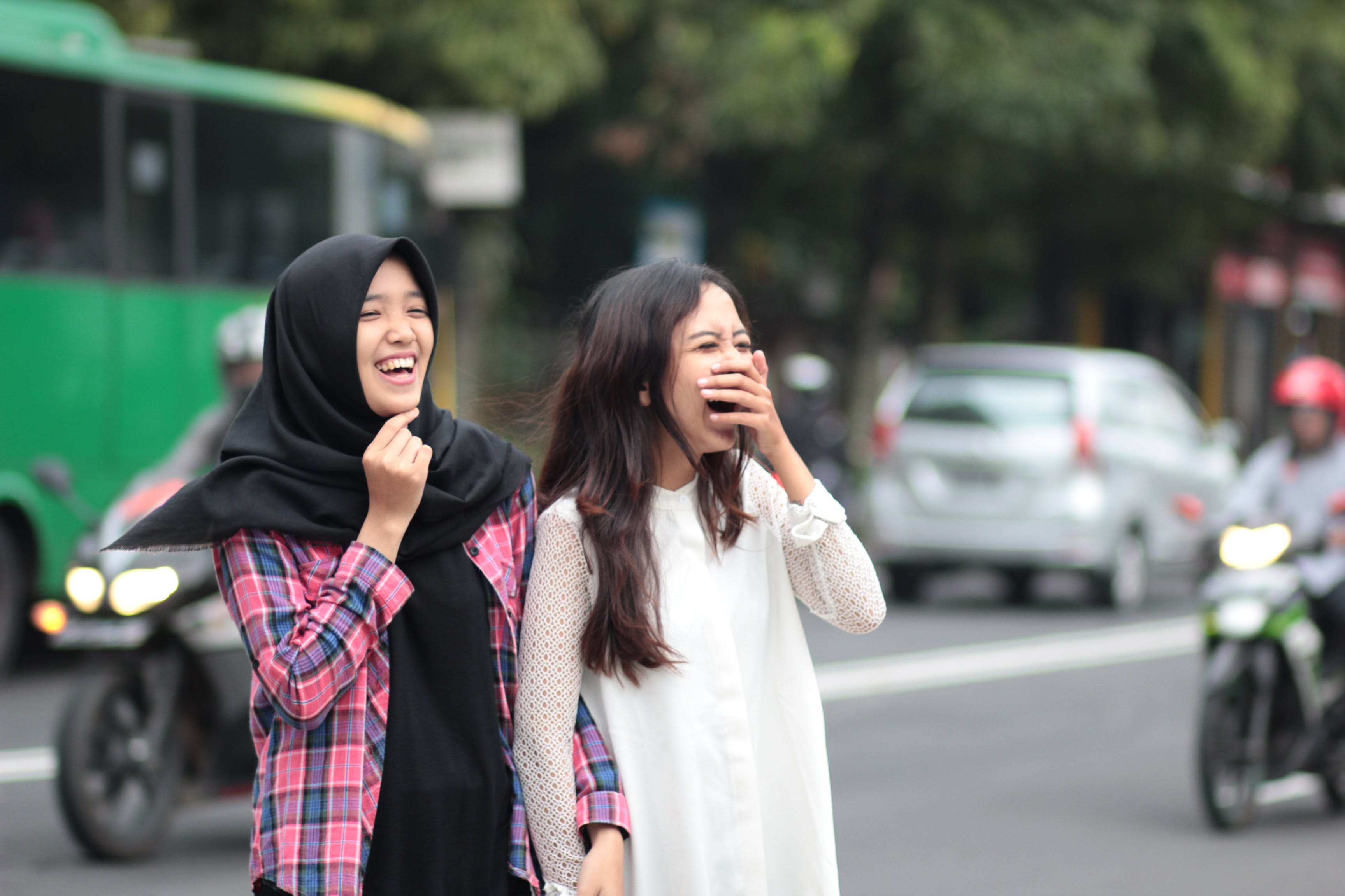 Two Women Laughing at Street