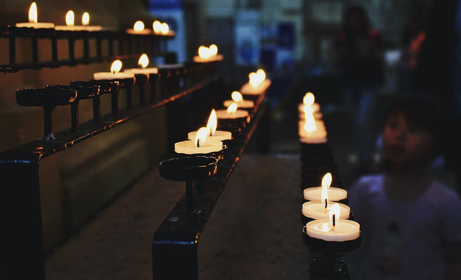 White Tealight Candles Lit during Nighttime