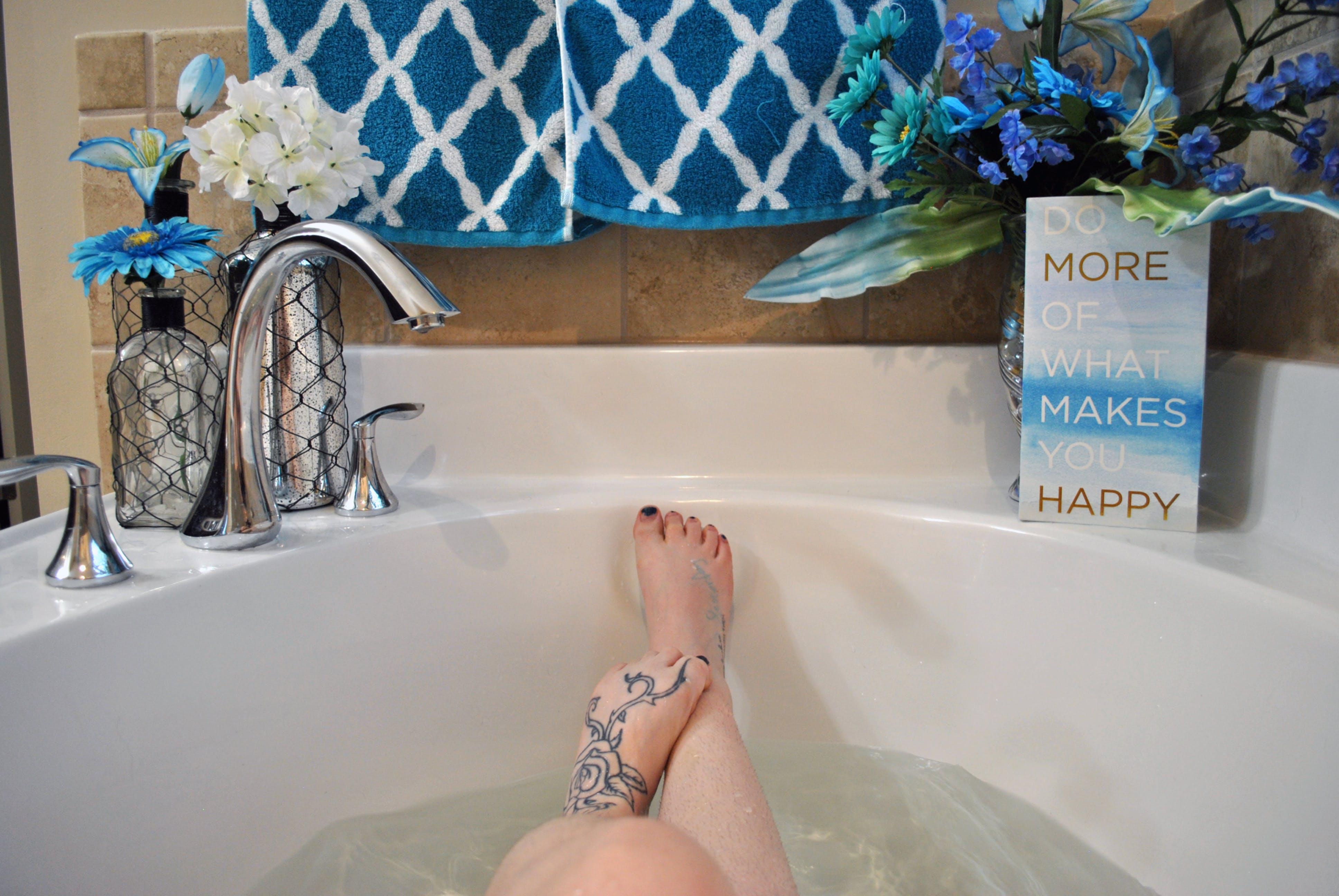 bath towels, bath tub, feet