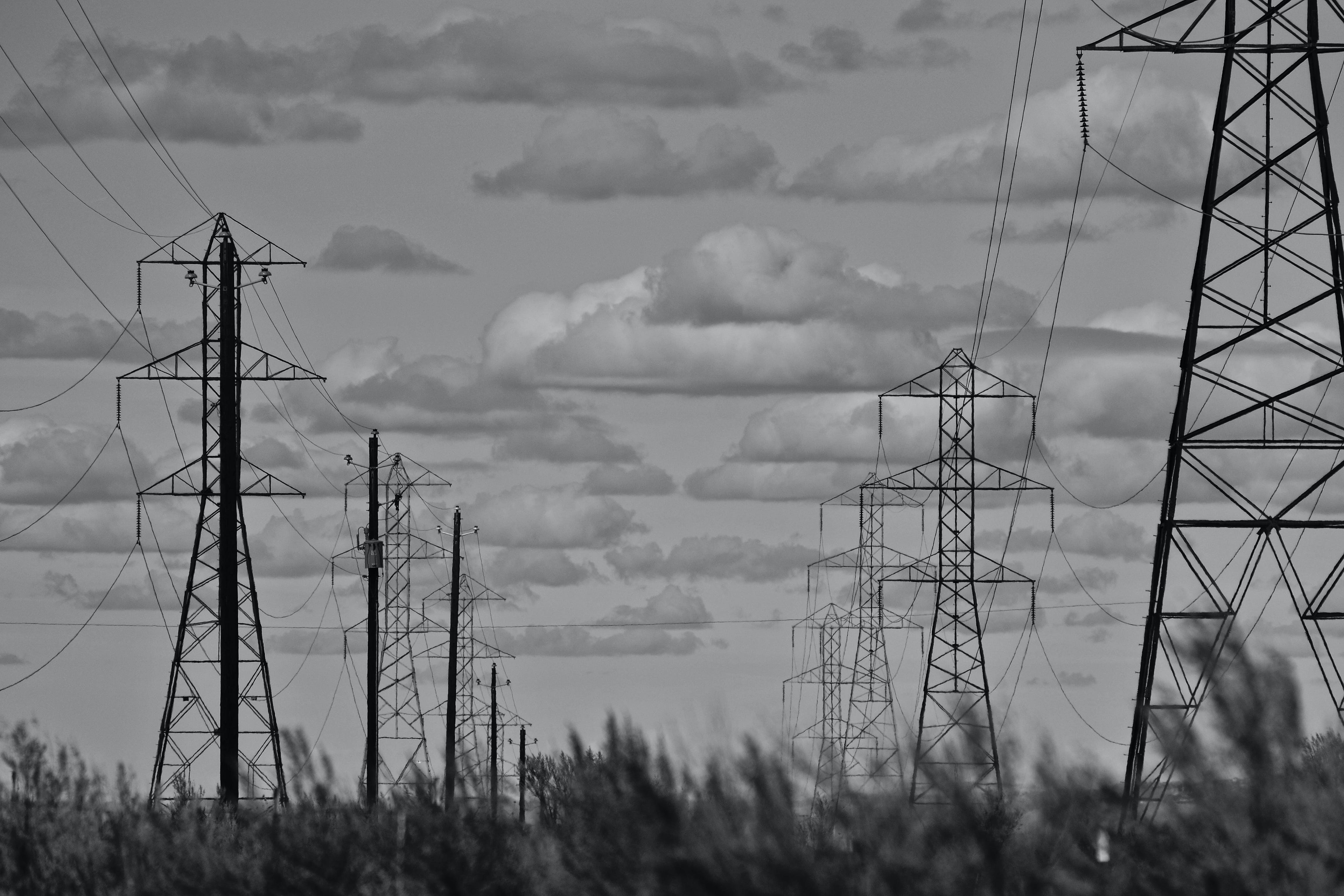 Grayscale Photo of Electricity Towers