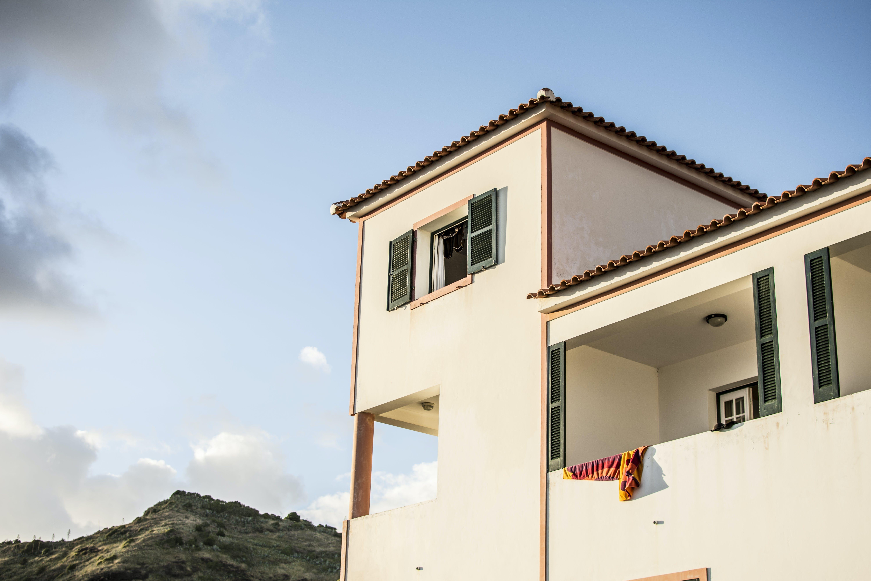 White Concrete House Under Blue Sky