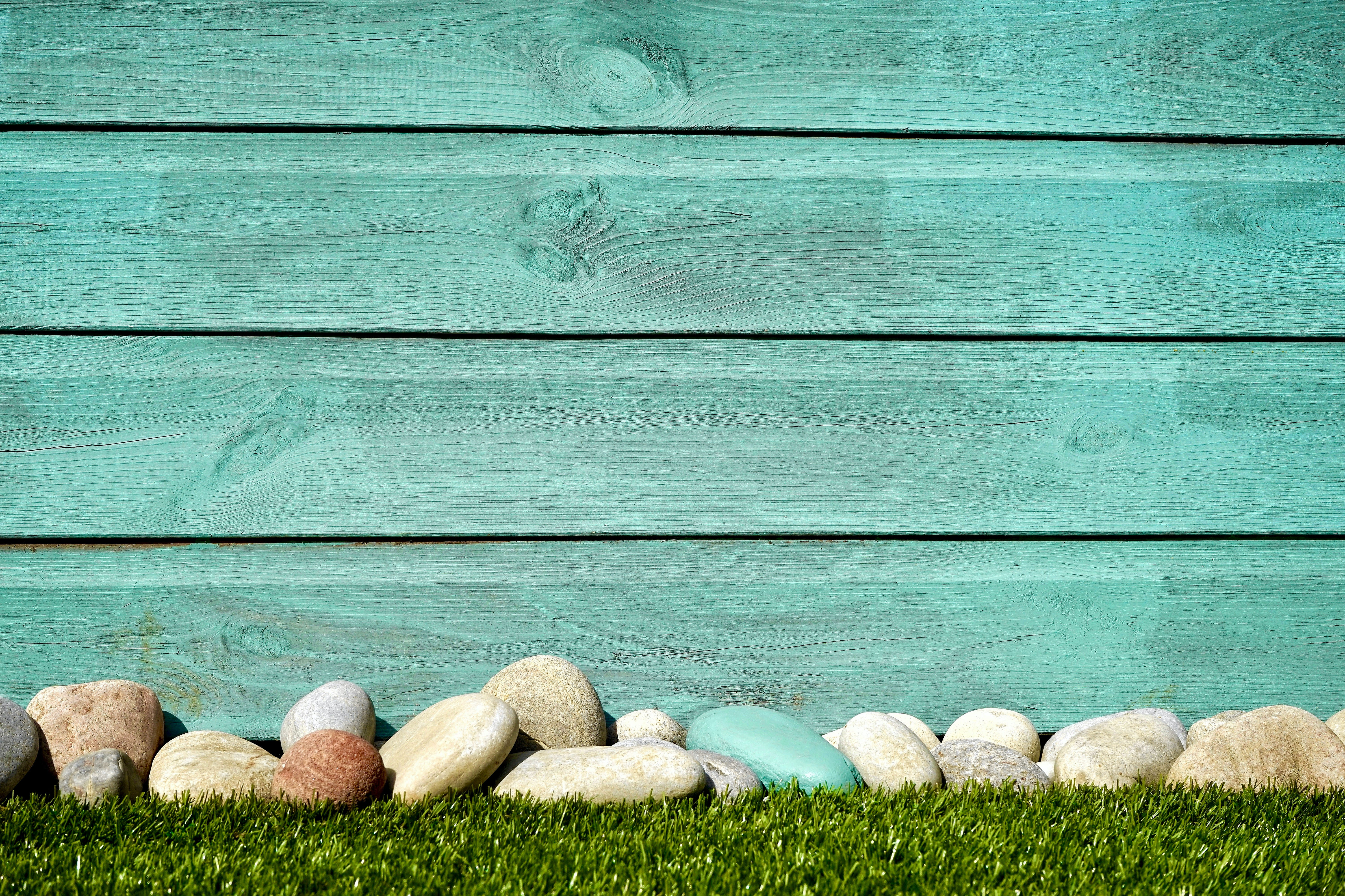 Pile of White and Blue Stones in Front Blue Painted Wall