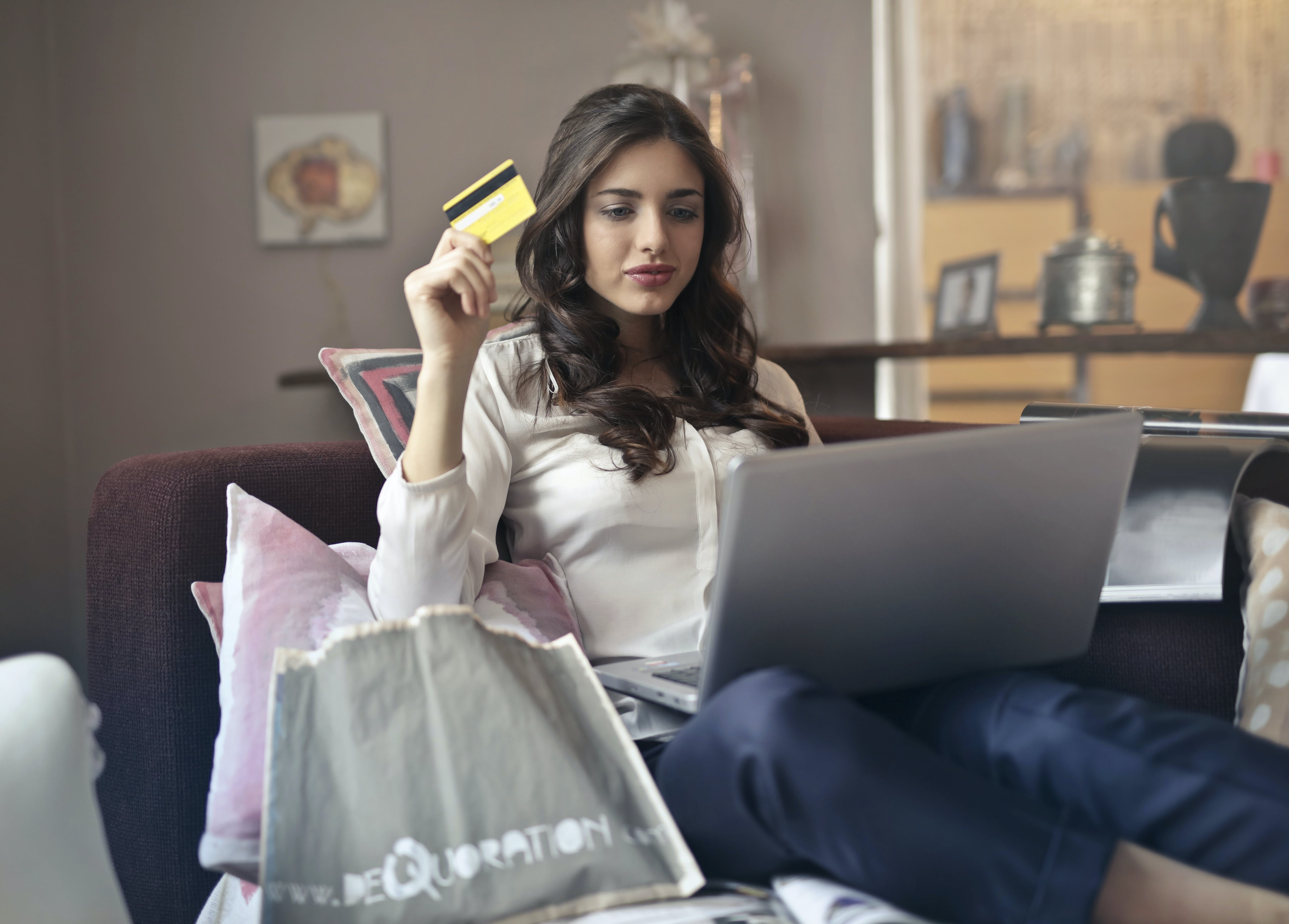 woman holding card while shopping