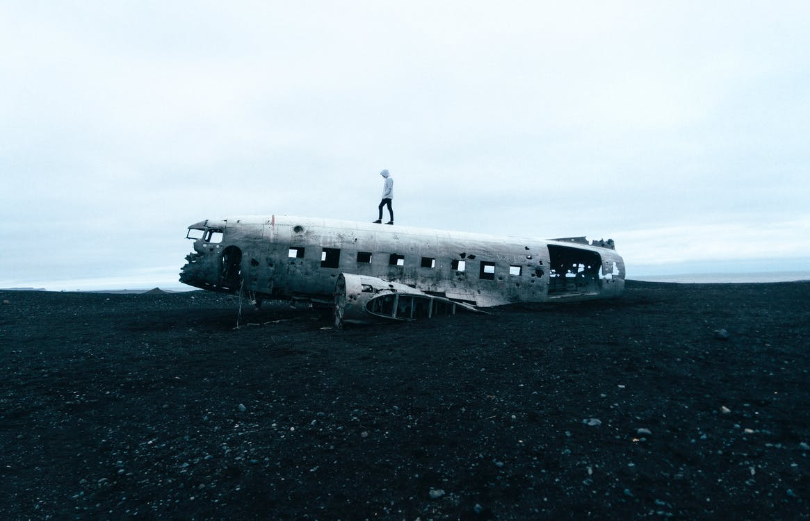 Person Standing on Wrecked Plane