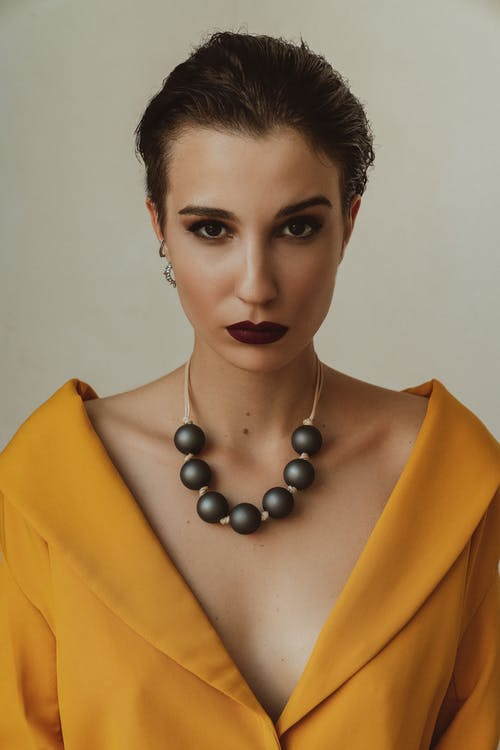 Woman with Black Pearl Necklace and Yellow Dress