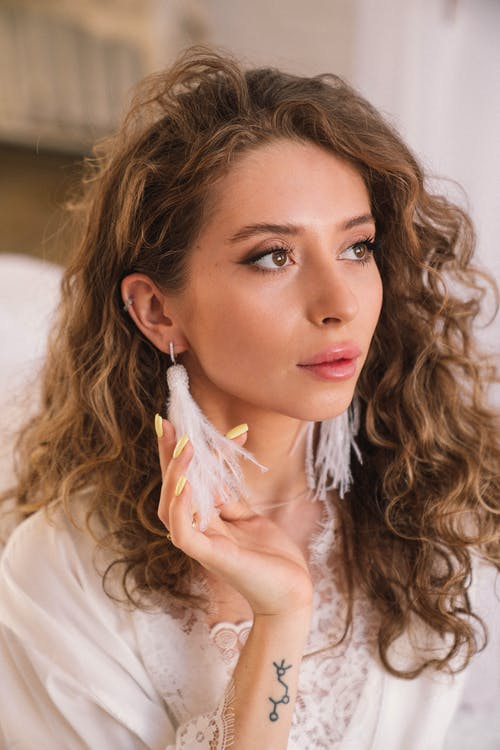 Woman Wearing Dangling Earrings