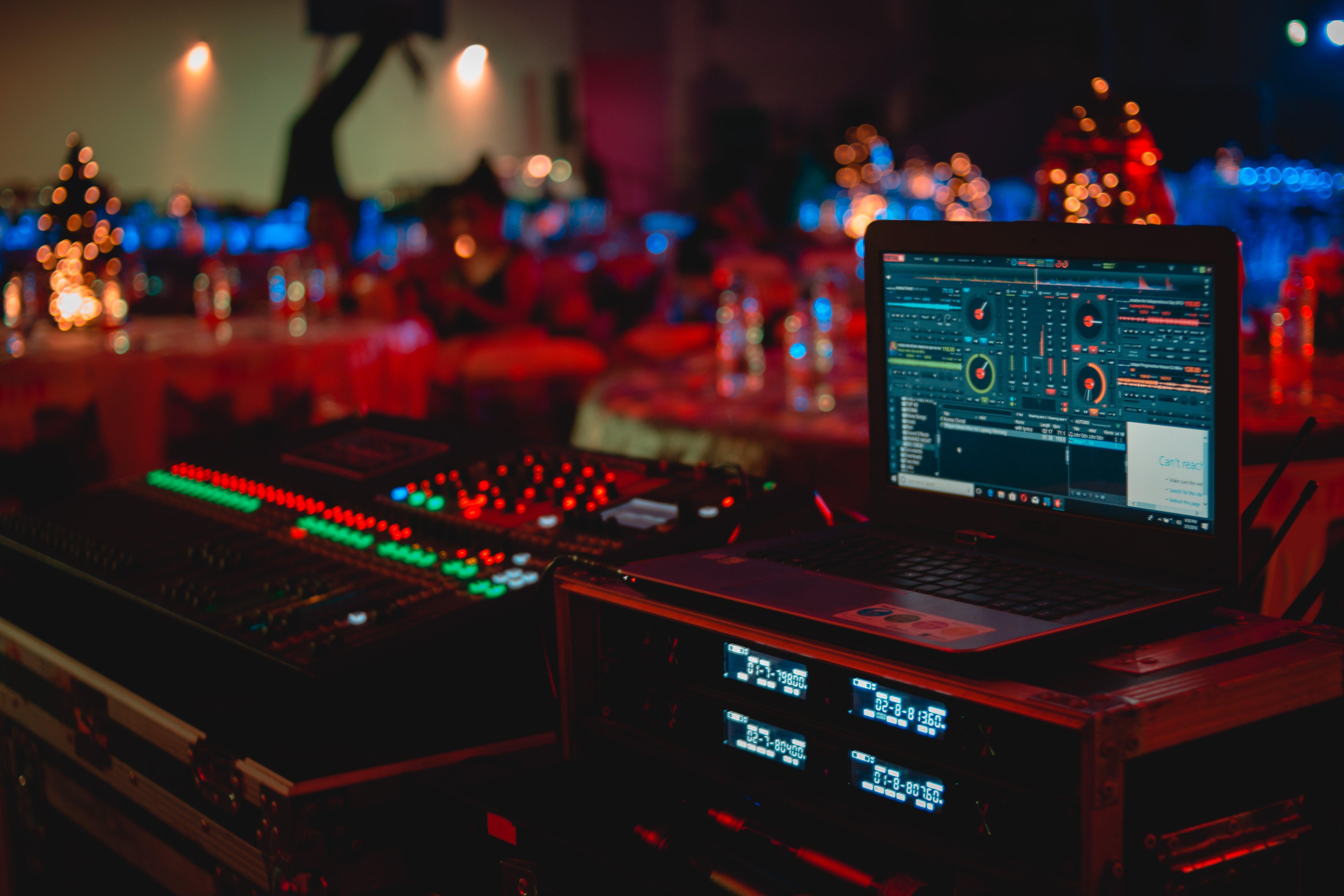 Black Laptop Beside Audio Mixer Set