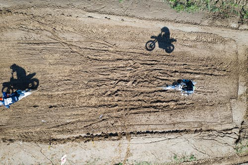 Persons Riding Dirtbikes