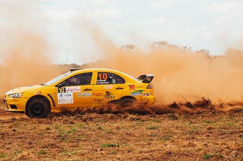 Yellow Racing Car on Brown Ground