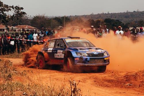 Blue Racing  Car on Race Track
