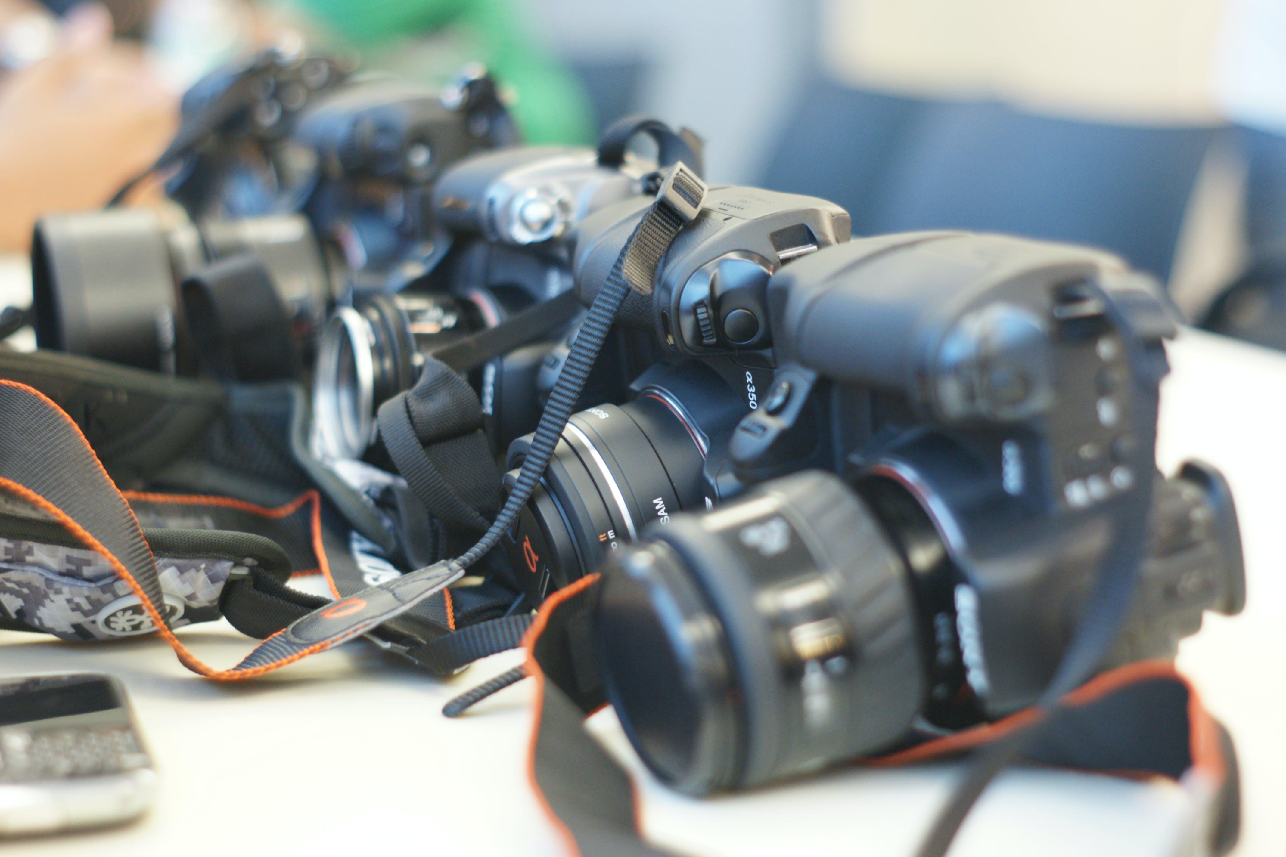 Free stock photo of camera, camera lens, camera strap, cameras