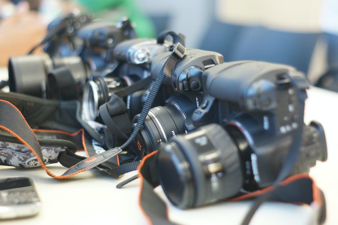 Free stock photo of camera, camera lens, camera strap