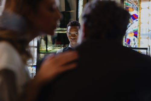 Man in Black Suit Jacket Standing Beside Woman in Black Shirt